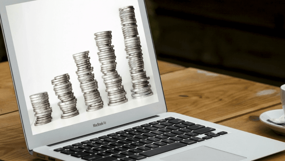 Laptop screen with coins representing websites dealing with financial content